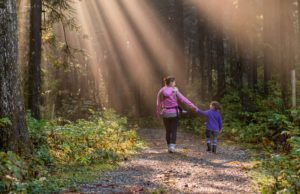 foster carer and child in woods