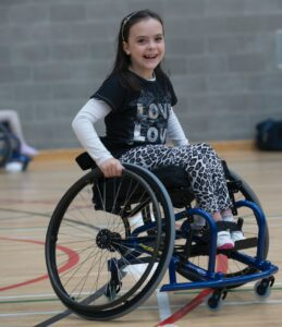 girl in sports wheelchair